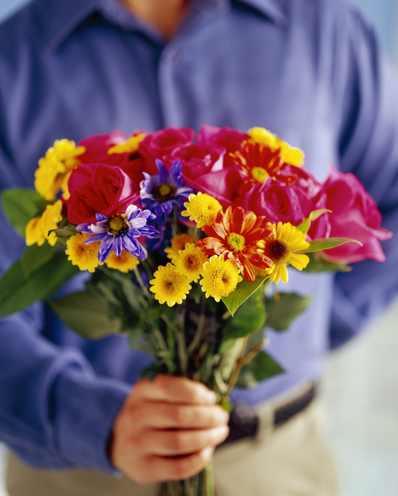 Guy giving flowers