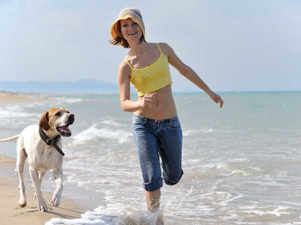 woman jogging with her dog